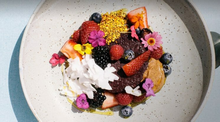 Plate of beautifully arranged fruit and flowers