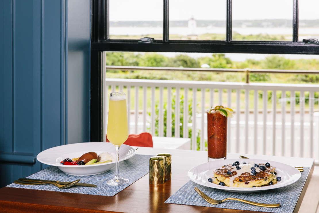 Two Breakfast plates by the window in Bettini.
