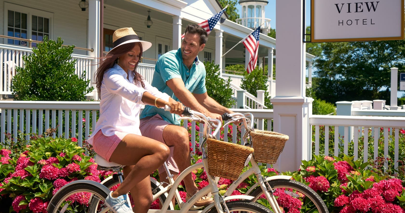 A couple riding bikes at the Harbor View Hotel