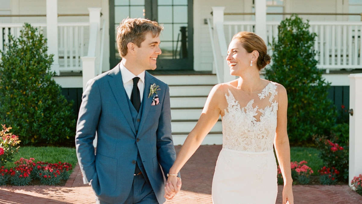 Bride and Groom holding hands walking together