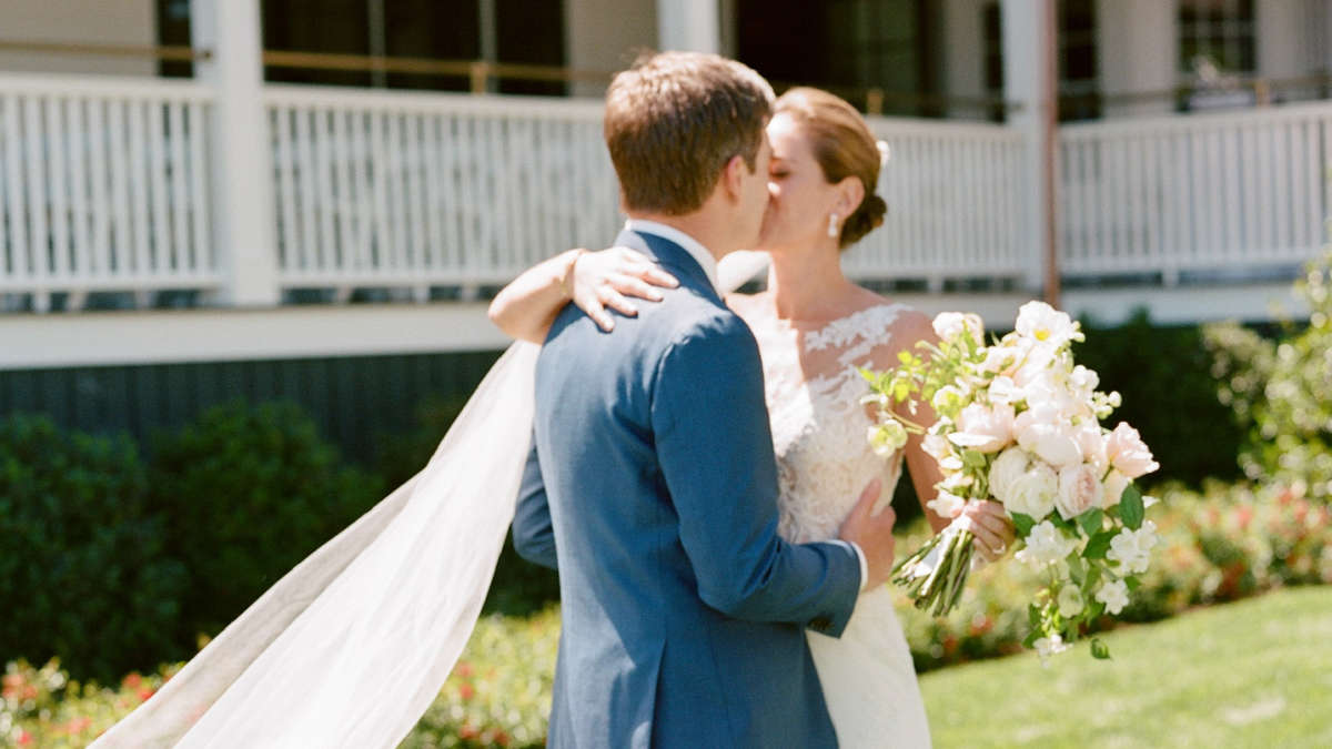 Bride and Groom kissing each other on hotel grounds