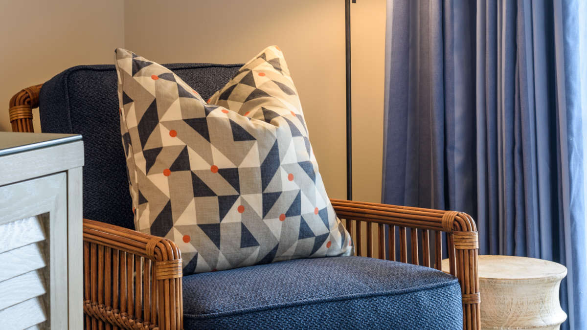 Blue chair in bedroom