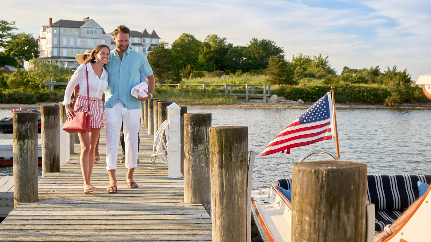 Couple walking on the dock together
