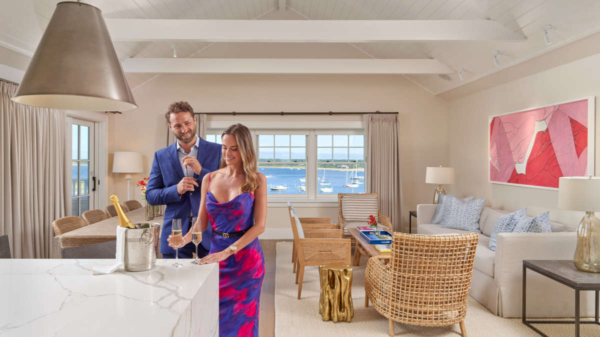 Couple standing in the open concept kitchen living room