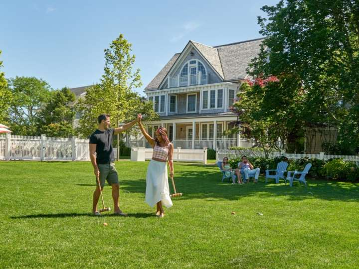 Couple walking on cottage lawn together