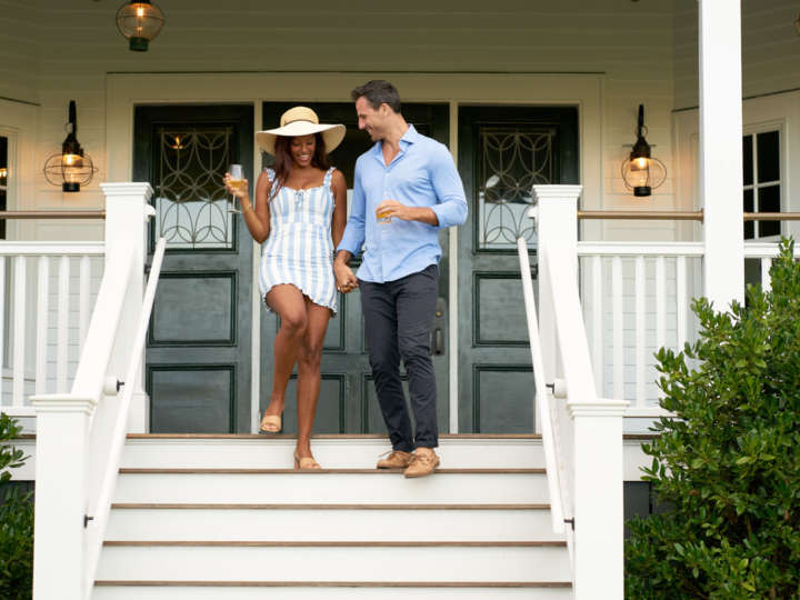 Couple walking down the front deck stairs