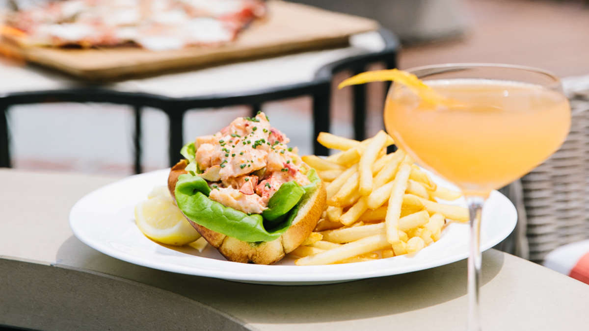 Lobster roll and fries on a plate