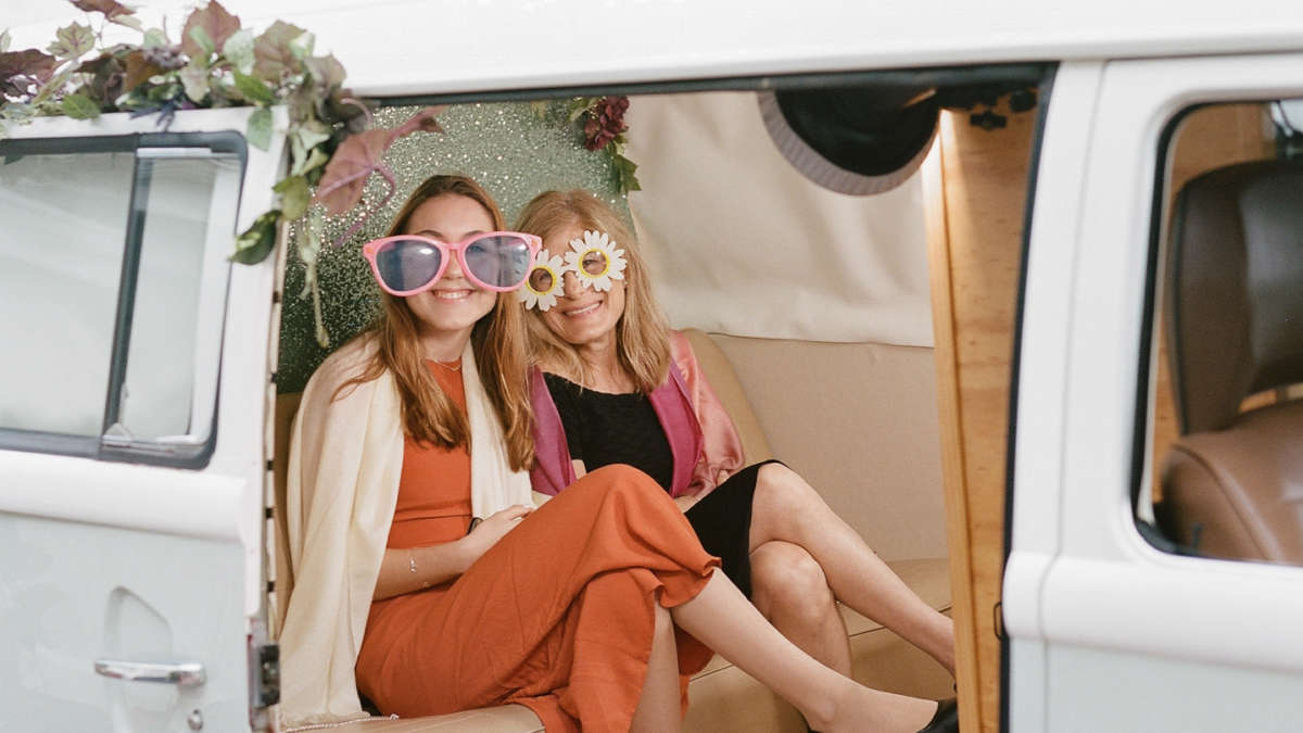 Guests with props in the photo booth van