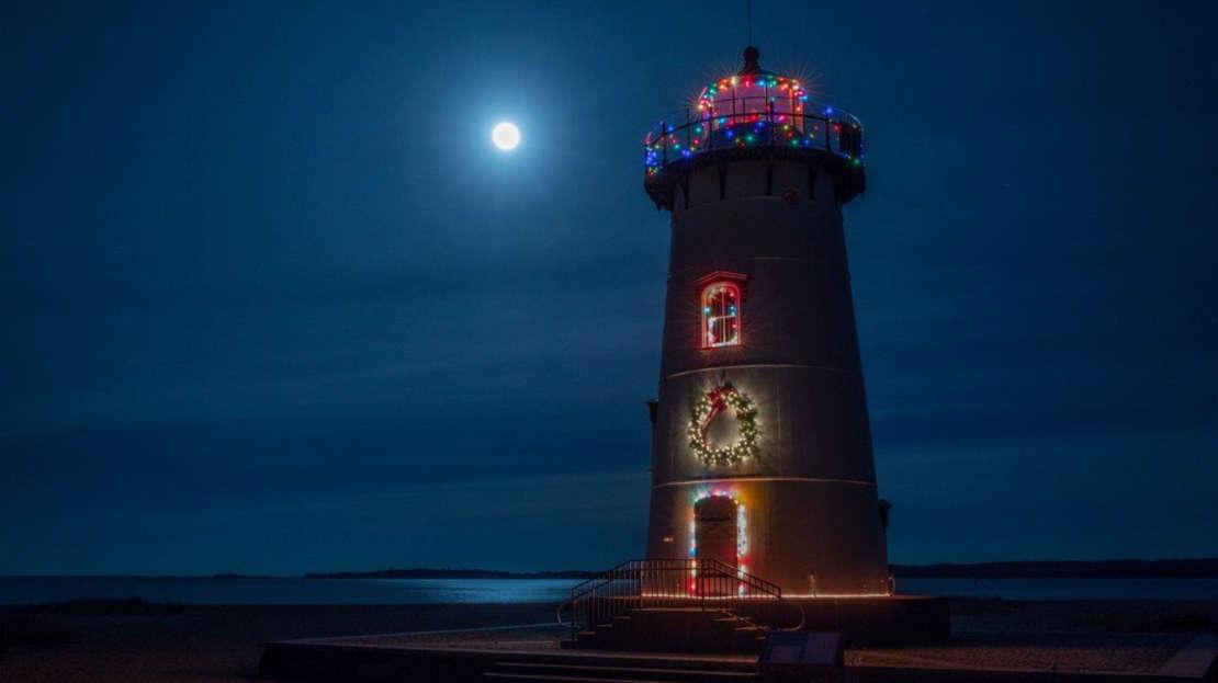 Lighthouse lit up with Christmas lights
