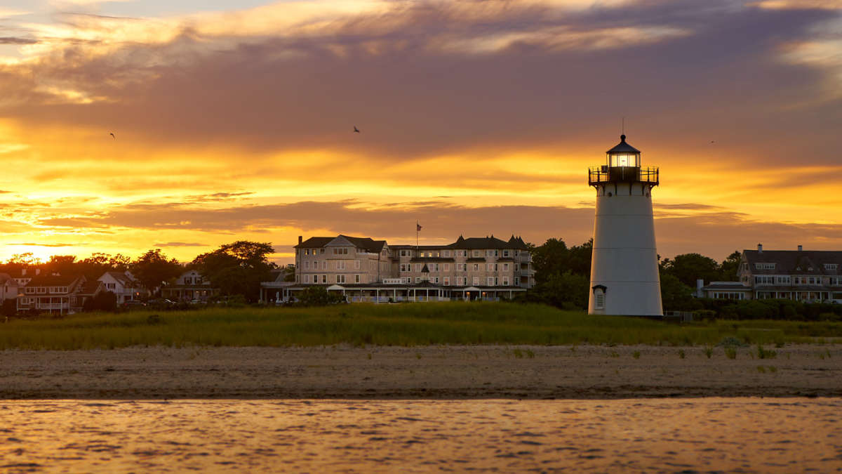 Yellow sunset with the lighthouse and HVH hotel in the background