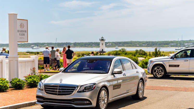 Silver Mercedes car parked by the shores