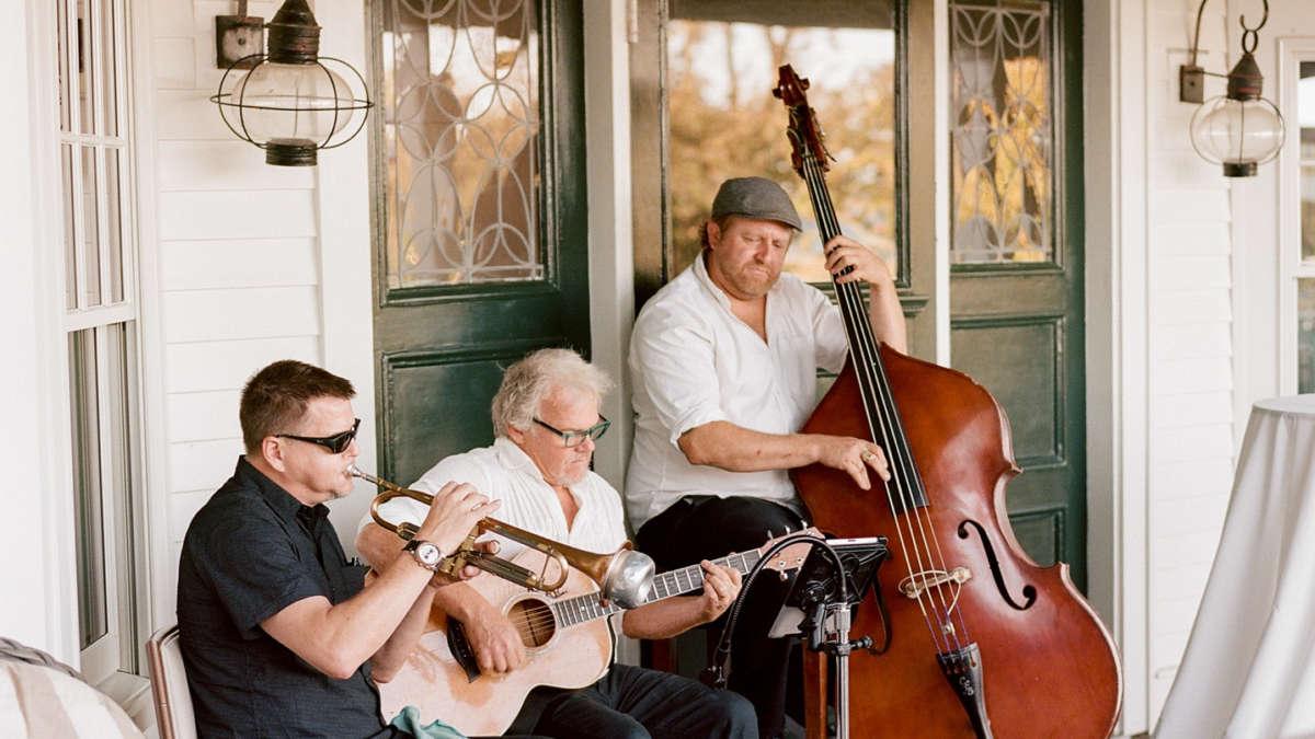 Musicians playing on the veranda