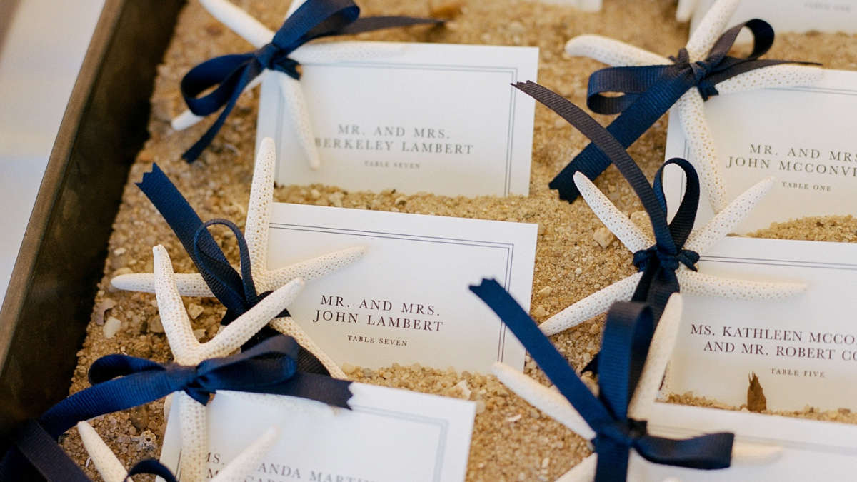 Table place cards in box of sand