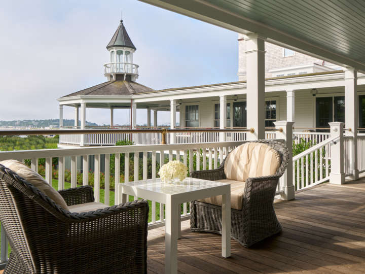 Veranda with lounging chairs and tables