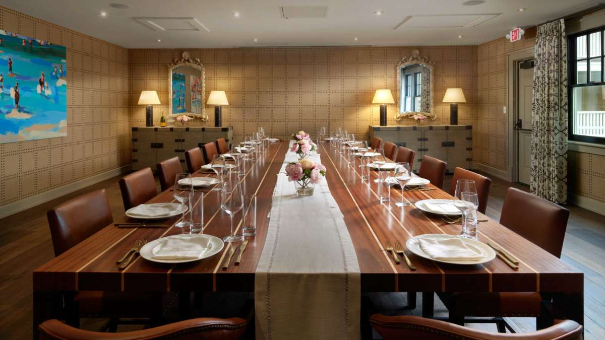 Private dining room with a large long table and place settings