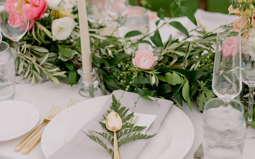 Beautiful plate and table display at outdoor wedding