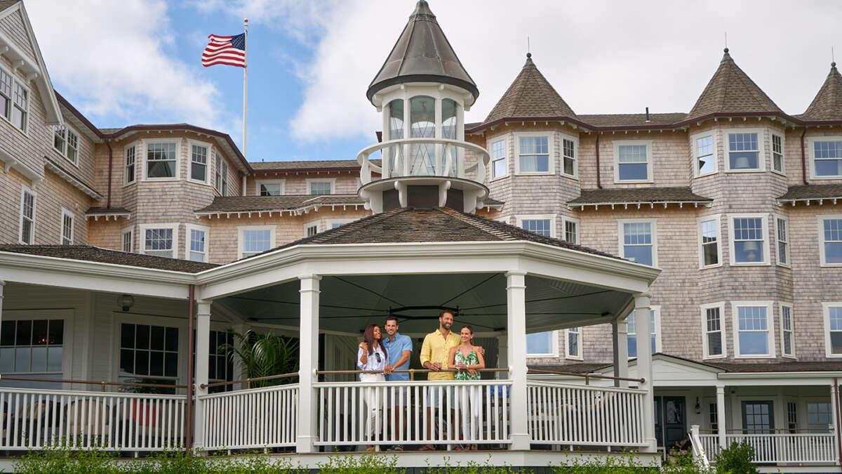 2 men and 2 women on the veranda