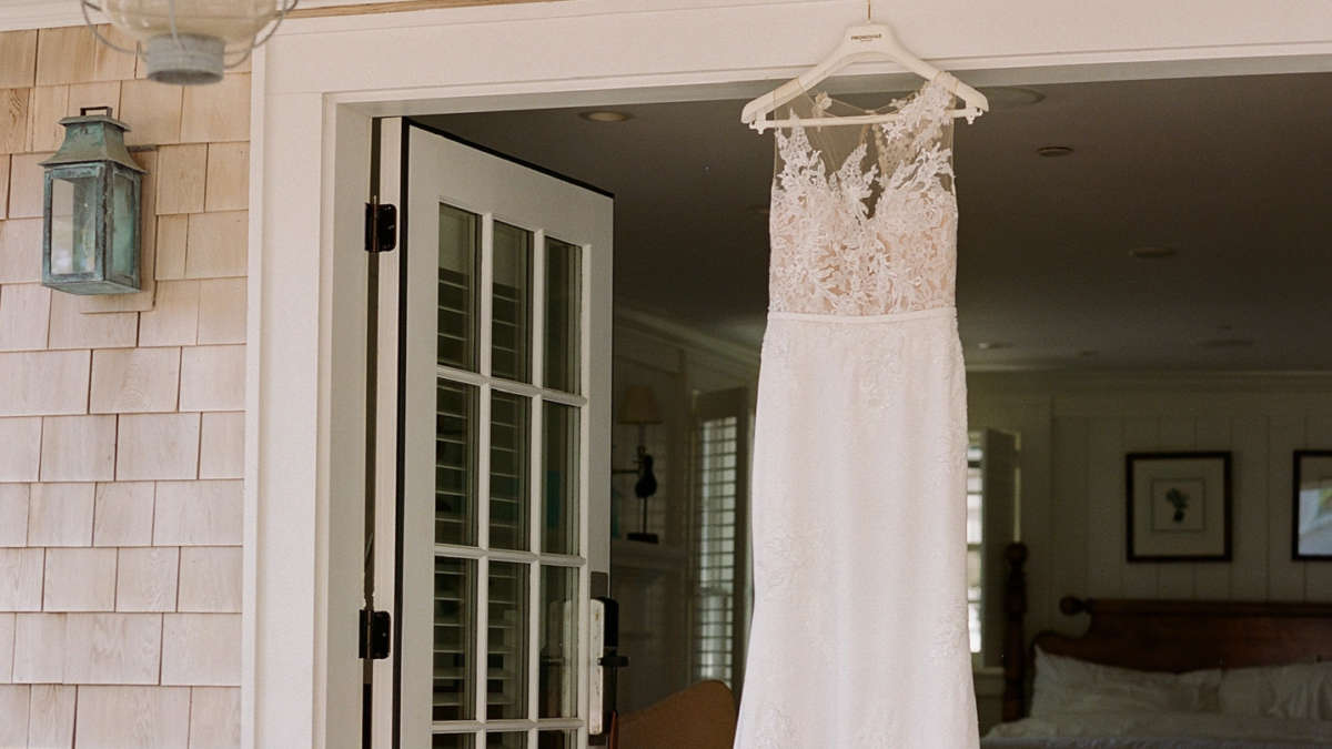 Wedding dress hanging on a door frame