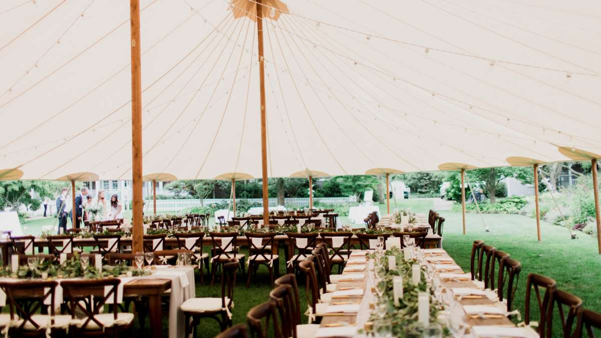 Tables under a tent set up for a wedding