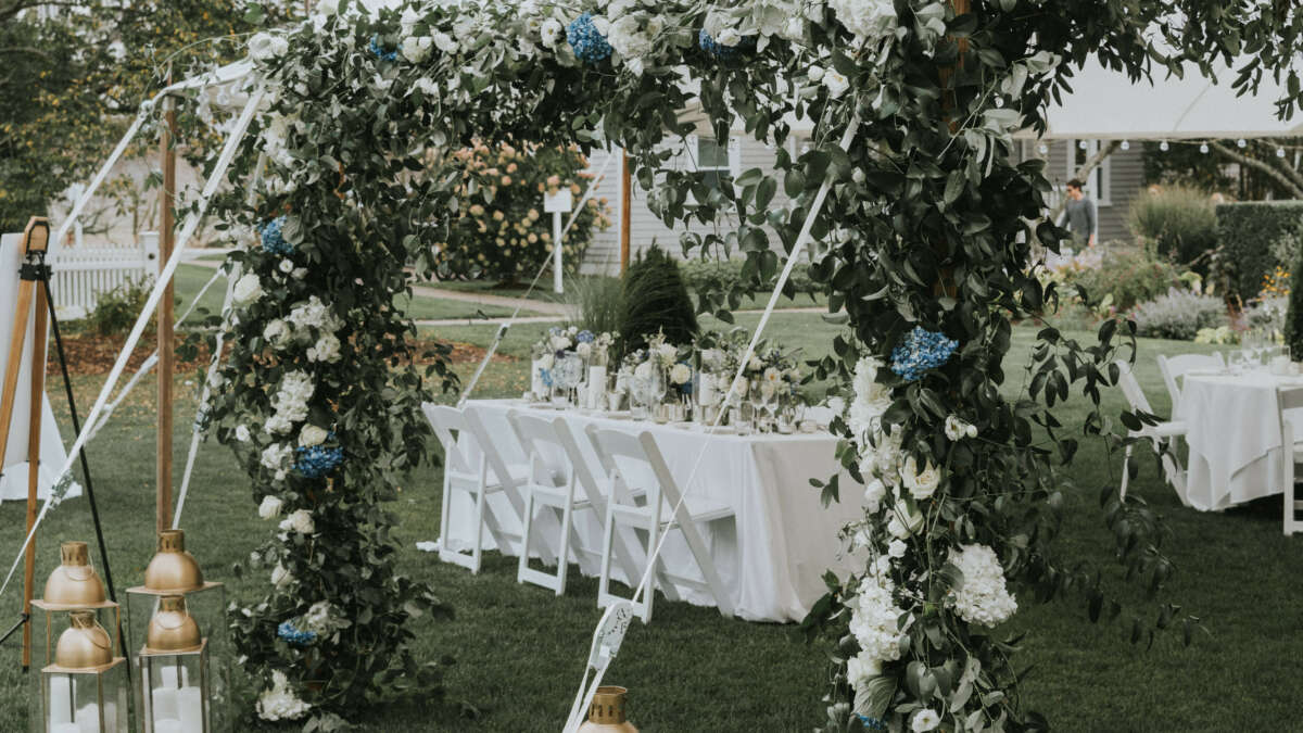 a wedding tent with flowers and lantern