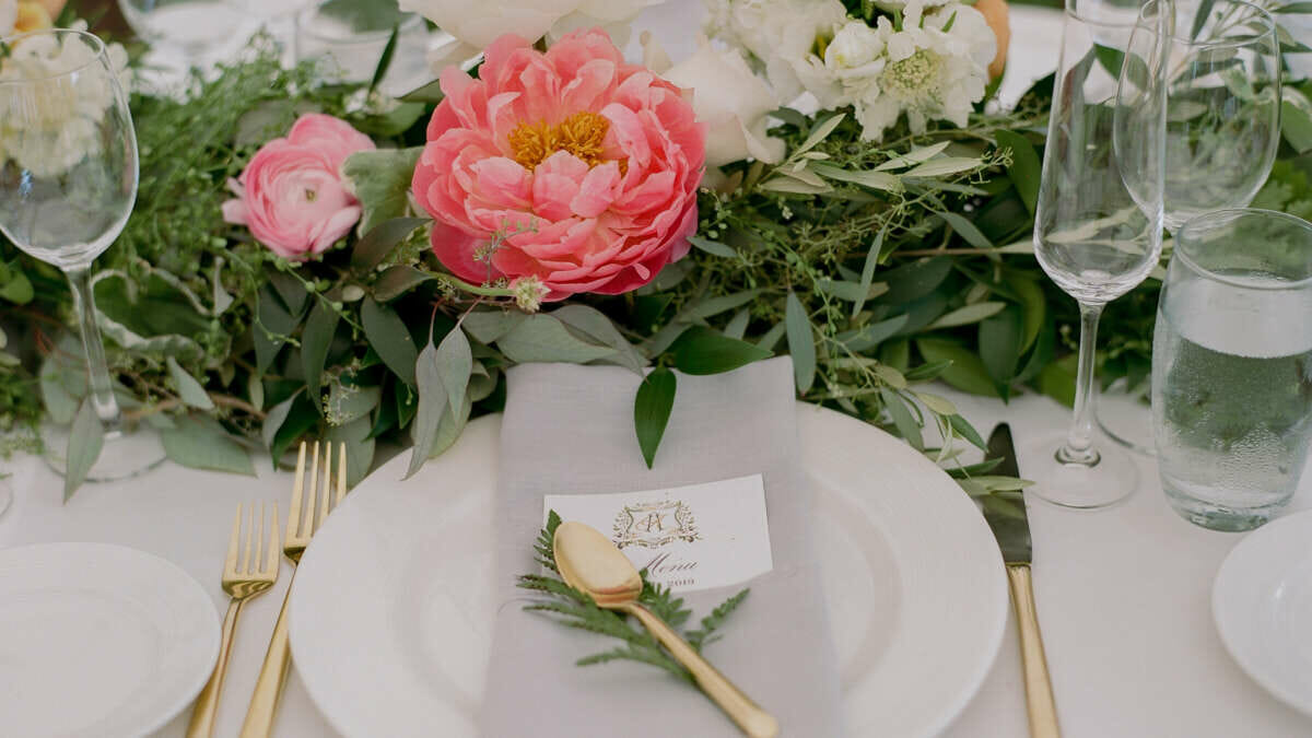 A pink flower and table setting