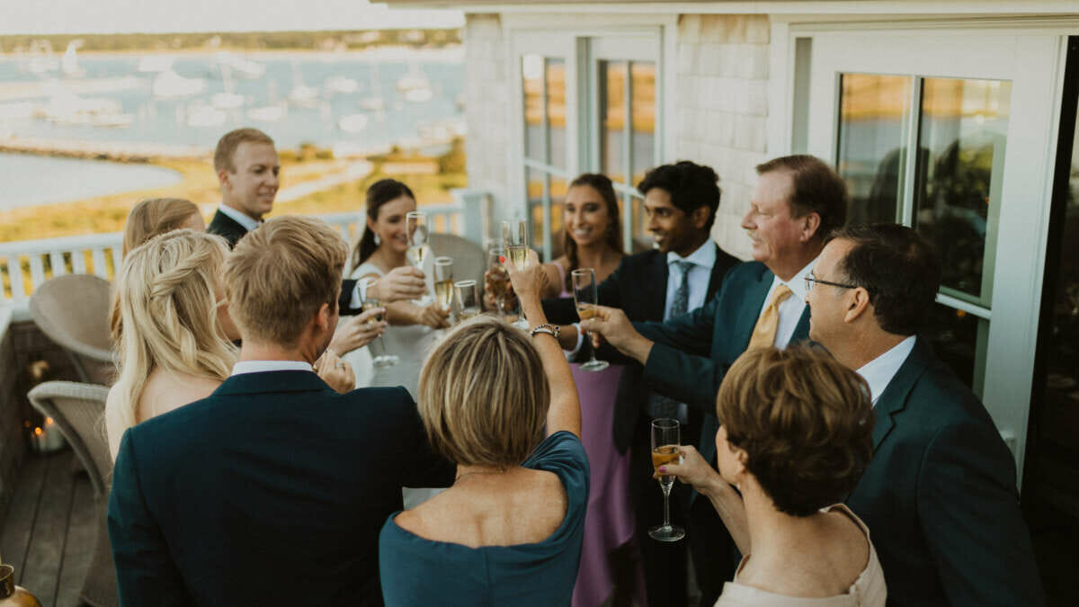 A group of people cheering with champagne glasses