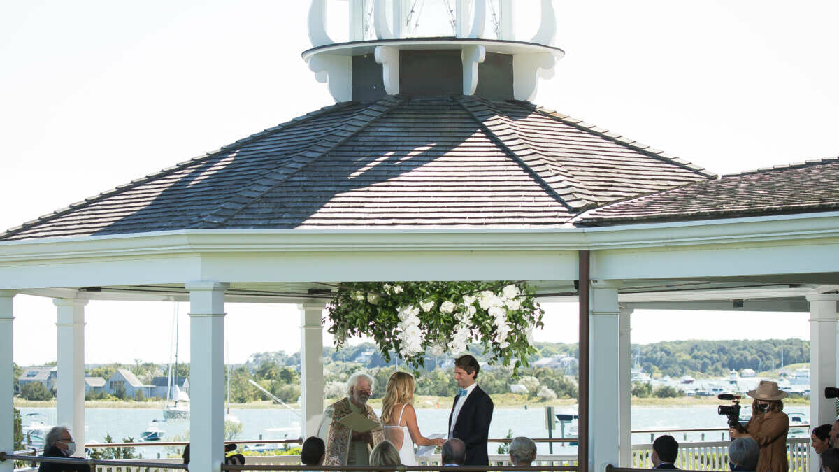 a gazebo with a man and woman getting married
