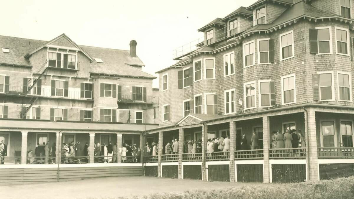 A black and white photo of the harbor view hotel exterior