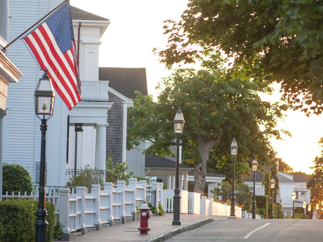 a street with lamps and an american flag
